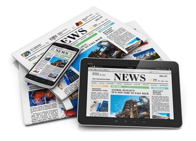 Zeitung und Handy auf einer Zeitung liegend